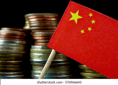 People's Republic of China flag waving with stack of money coins macro