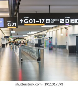 Peoples walking in airport terminal. Departure gate signpost on airport. Shallow focus, blurry background. Travel concept