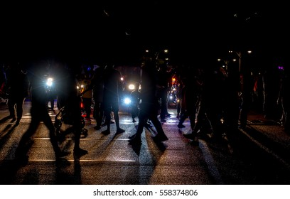 Peoples walking on street at night in silhouette soft shadow motion blur concept