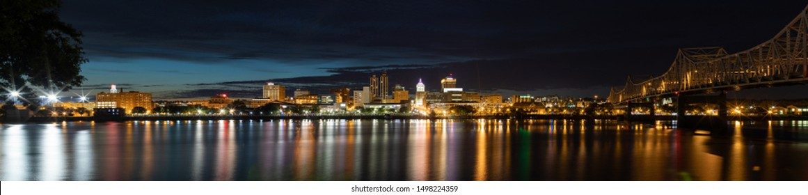 Peoria, in the state of Illinois, United States of America, at night, across the Illinois River