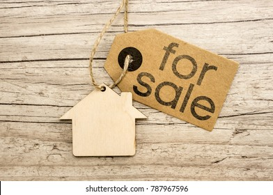 Peper tag on wooden house cutout close up writing for sale