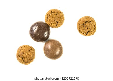Pepernoten bunch of traditional and chocolate  treats on white background for annual Sinterklaas holiday event in the Netherlands on december 5th