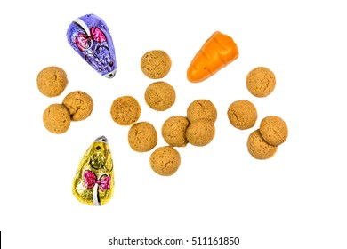 Pepernoten cookies with chocolate mice and marzipan carrot as Sinterklaas decoration on white background for dutch sinterklaasfeest holiday event on december 5th