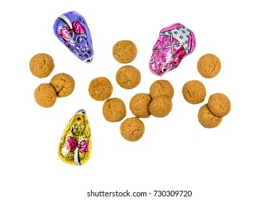 Pepernoten cookies and chocolate mice as Sinterklaas decoration on white background for dutch sinterklaasfeest holiday event on december 5th