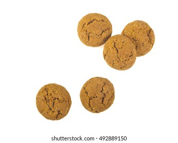 Pepernoten cookies seen from above as Sinterklaas decoration on white background for dutch sinterklaasfeest holiday event on december 5th