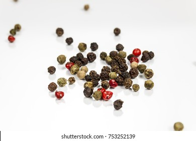 Pepper beans isolated on reflective white surface
