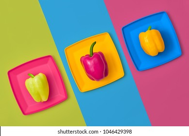 Pepper Fresh on plate. Food Organic Vegan Concept. Colorfull Vegetables. Flat lay. Trendy fashion Style. Minimal Design Art. Hot Summer Vibes. Bright Green Pink Color