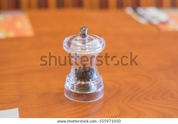 Pepper Grinder Over Wooden Table On Stock Photo Edit Now 555971050