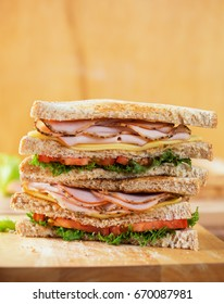 pepper ham cheese sandwich with whole wheat bread on wooden board