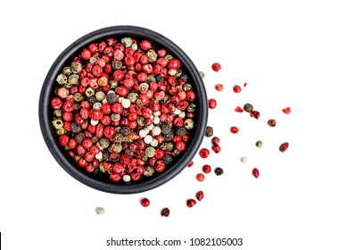 Pepper mix. Black, red and white peppercorns isolated on white.