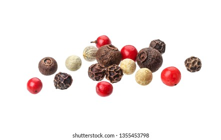 Pepper mix. Heap of black, red, white and allspice peppercorns isolated on white background, close up