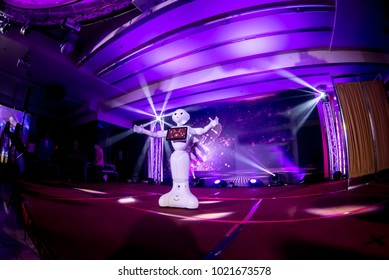 Pepper Robot is dancing on stage with concert light.February 2, 2018 in Taipei,Tanwan