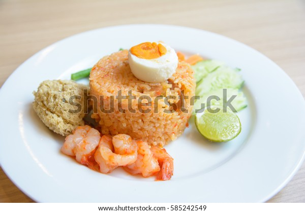 Pepper shrimp fried rice and fried fish paste.