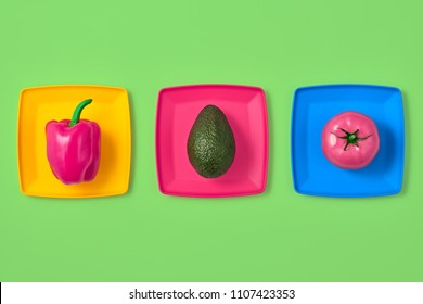 Pepper Tomato Avocado Fresh. Food Organic Vegan Concept. Creative Flat lay. Trendy fashion Style. Minimal Design Art. Hot Summer Vibes. Vegetables on plate. Bright Green Color.