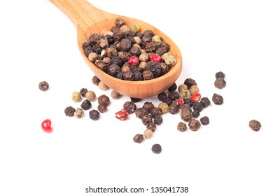 Pepper in a wooden spoon isolated on a white background