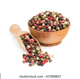 peppercorn mix in a wooden bowl isolated on white