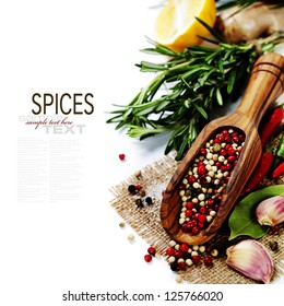 Peppercorn mix in wooden scoop, herbs and spices (with easy removable text)