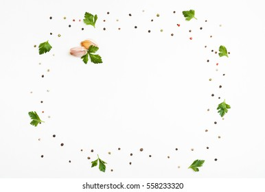 Peppercorns, parsley, garlic background. Copy space. Top view