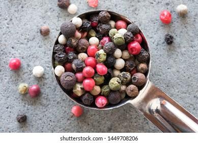 Peppercorns Spilled from a Teaspoon
