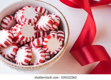 Peppermint Candy Discs in a Bowl with Red Ribbon