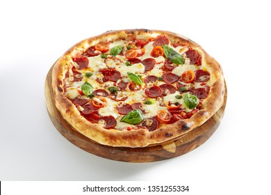 Pepperoni or Diabola Pizza with Salami, Chili Pepper, Mozzarella Cheese, Fresh Basil, Cherry Tomatoes, Tomato Sauce Isolated on White Background. Traditional Italian Flatbread on Wood Plate Close Up