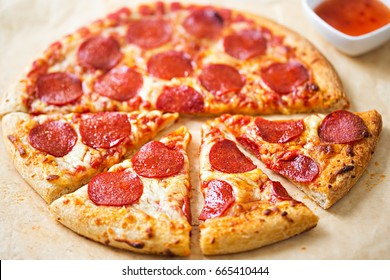 Pepperoni pizza with chilli dip