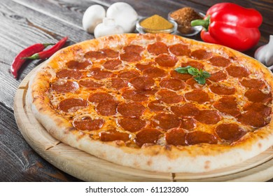 Pepperoni pizza. Macro. Creative author's pizza. This is a series of different pizzas. The main types of pizza are photographed from one angle.