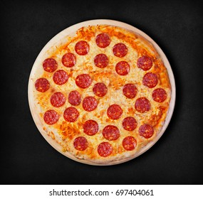 Pepperoni pizza on a black background. Visit my page. You will be able to find an image for every pizza sold in your cafe or restaurant.