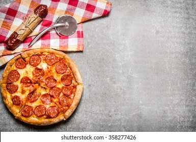 Pepperoni pizza with salami and cheese. On the stone table. Free space for text . Top view