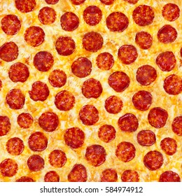 Pepperoni Pizza. A seamless food texture. Use this texture in fabric and material prints, image backgrounds, posters and menus, invitations, collage, gift wrap, wallpaper, within type designs etc.