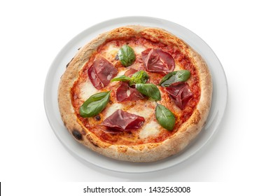 Pepperoni pizza with spinach and bacon on a white plate.