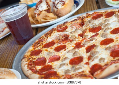 Pepperoni and Sausage Pizza with Beer