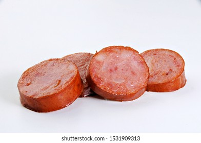 pepperoni sausage slices on white background