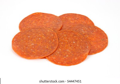 Pepperoni slices on white background