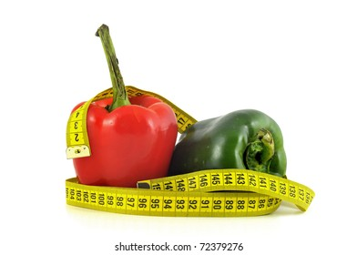 Peppers with measuring tape isolate in white