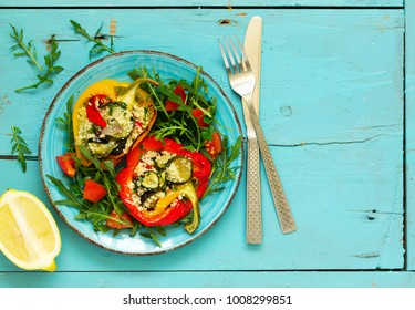 peppers stuffed with couscous salad with vegetables.