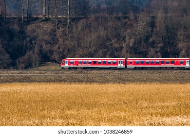 Perach,Germany-March 4,2018: A train belonging to the german railroad crosses the bavaria countryside