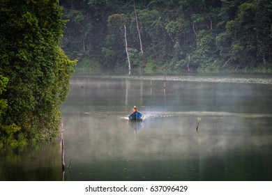 PERAK, MALAYSIA - 20TH MARCH 2017; Local tourist enjoying a boat ride in Royal Belum Rainforest Park, is believed to have been in existence for over 130 million years.