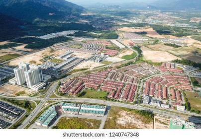 Perak, Malaysia - August 12, 2018 : Aerial view of  Meru City, Bulatan Amanjaya and North South Highway at Ipoh, Perak. Selective focus and crop fragment