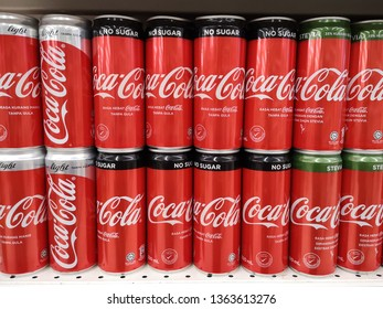PERAK, MALAYSIA - DEC 08, 2018: Coca cola cans stacked on a shelf in a supermaket