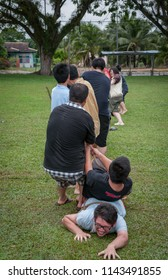 Perak, Malaysia.  December 13, 2017 : Church of Sitiawan youth having fun competing tug of war game at Chinese School field Kg Koh.