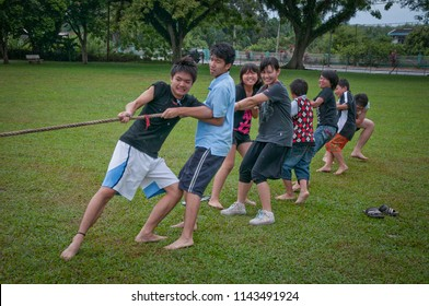 Perak, Malaysia.  December 13, 2017 : Church of Sitiawan youth competing tug of war game at Chinese School field Kg Koh.