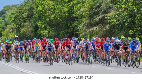 PERAK, MALAYSIA - FEBRUARY 25, 2016: Riders compete during Le Tour de Langkawi (LTDL) 2016. LTDL is a multiple-stage bicycle race held in Malaysia.