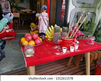 Perak, Malaysia, February 9,2019 : Chinese ancestral altar worshipped was displayed on red table outside one of the houses at Concubine lane, Ipoh old town.
