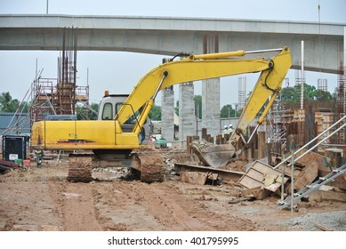 PERAK, MALAYSIA -JANUARY 02, 2016: Excavators machine is heavy construction machine used to do soil excavation work at the construction. Powered by long hydraulic arm with basket. Handle by workers.