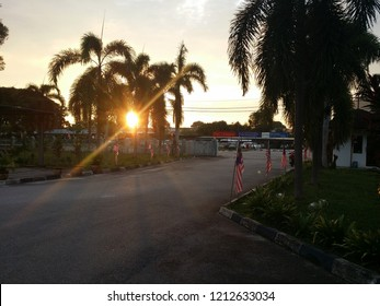 Perak, Malaysia.  October 26, 2018: Early sunrise with sunflares sneaking through the road at Sri Manjung town.