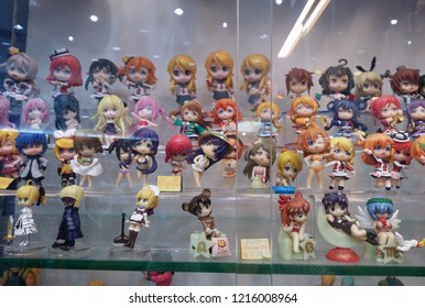 Perak, Malaysia. October 28, 2018: Japanese anime female cartoon character toys are exhibited inside the glass shelves for sale at Aeon Shopping Mall.