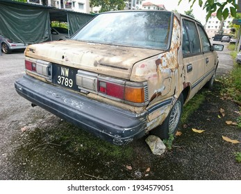 Perak, Malaysia-12 March 2021:Rusty abandoned car on a residential area.