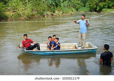 Perak,Malaysia - 20 February 2018 ; Unidentified a group of people looked happily riding boat on the Perak river.
