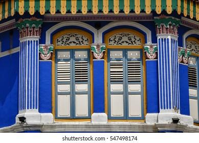 Peranakan shophouse along streets of Asia city Singapore